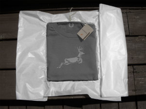 Charcoal t-shirt showing deer with packaging