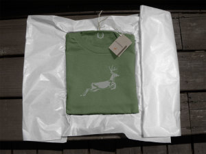 Green t-shirt showing deer with packaging