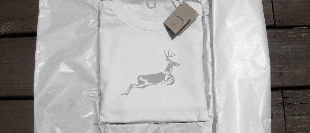 White t-shirt showing deer with packaging